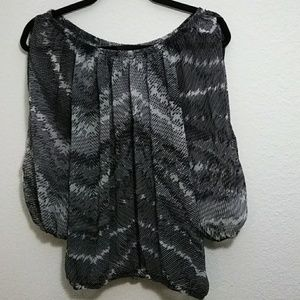 Printed see thru blouse with cut off sleeve design